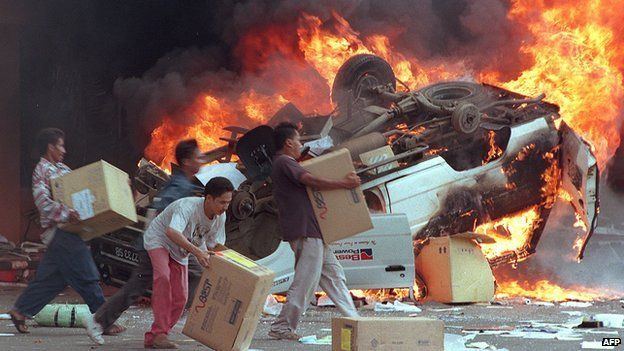 Angry Indonesian mobs burn cars and Chinese shops as they plundered shops in Jakarta on 14 May, 1998