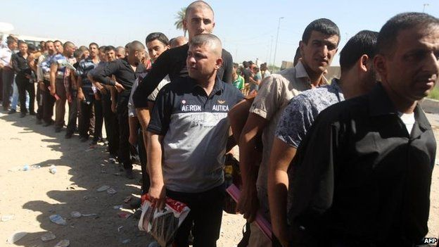 Recruits line up in Baghdad to join the fight against Isis, 24 June