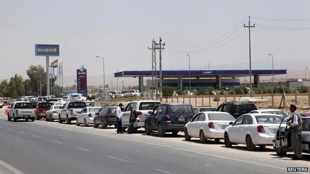 Cars queue for fuel in Irbil, 24 June