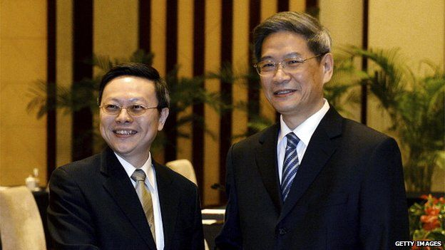 Taiwanese official Wang Yu-chi (left) who is in charge of the island's China policy meets with his Chinese counterpart Zhang Zhijun (right) from the Taiwan Affairs office at the Purple Mountain Guest House in Nanjing on 11 February 2014.