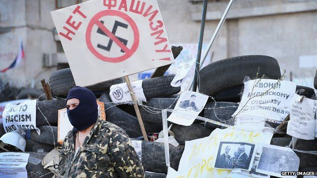 A pro-Russian activist guards the front of the Donetsk Regional Administration building on 18 April 2014 in Donetsk, Ukraine.