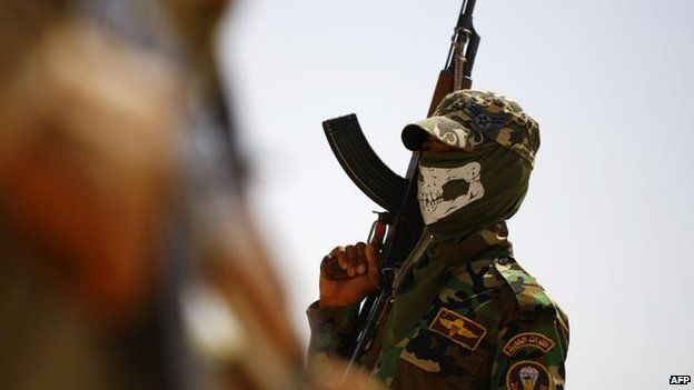 Iraqi Shia fighters secure an area to the west of the city of Najaf, 28 June