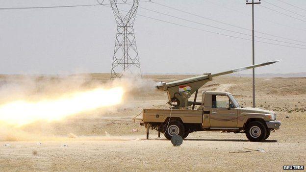 Kurdish security forces fire a missile towards Isis militants in Jalawla, Diyala province - 29 June 2014