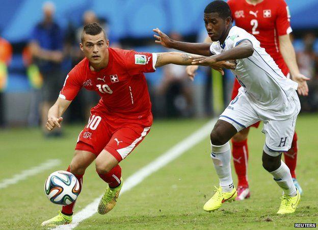 Switzerland's Xhaka is challenged by Garcia of Honduras (25 June)