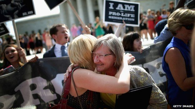 Anti-abortion advocates hugged in front of the Supreme Court on 30 June 2014