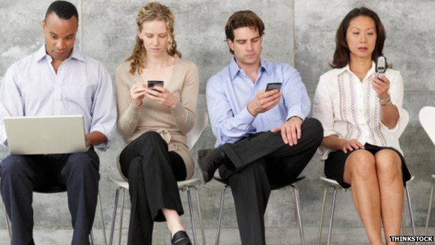 Four people on phones