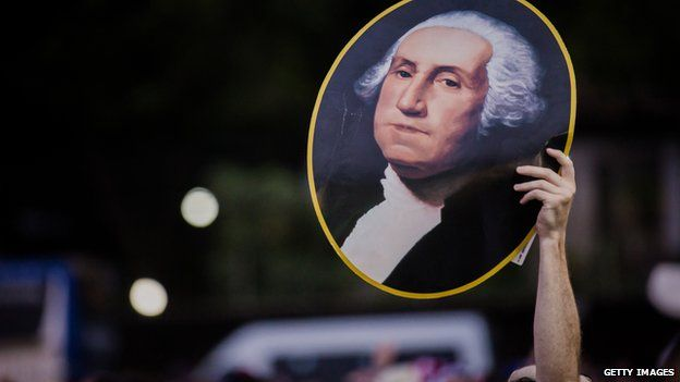 Before the match between Ghana and USA, a fan held up a poster of George Washington