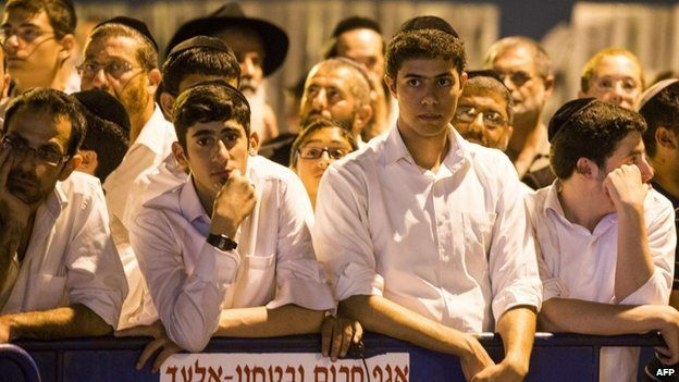Israelis gather in Elad, outside the house of Eyal Yifrach, one the three missing teenagers, on 30 June 2014