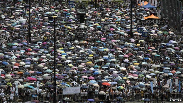 Thousands of pro-democracy protesters gather to march in the streets to demand universal suffrage in Hong Kong on 1 July, 2014