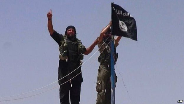 Isis fighters near Iraq-Syria border (file photo)