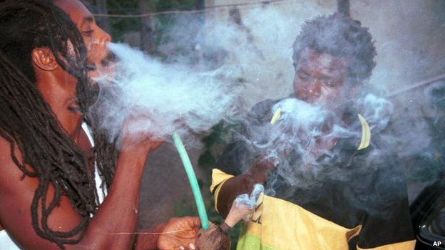A Rastafarian smoking marijuana, a sacrament in their religion