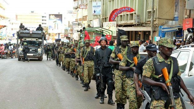 Soldiers and police patrol Kampala on 3 July 2014
