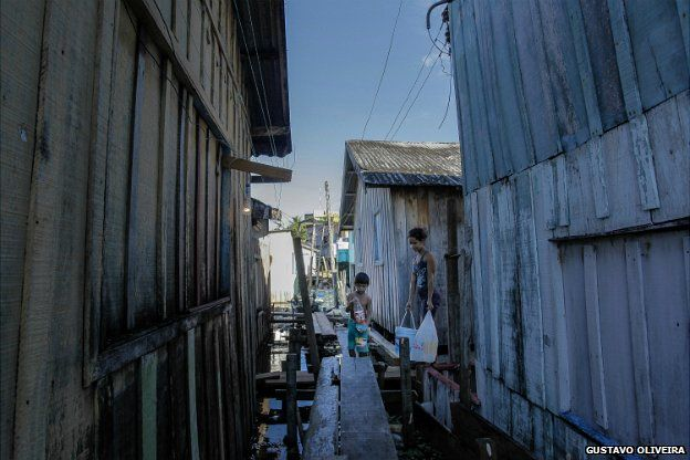 db1a80ddb34 ... Local residents use makeshift bridges to move between the buildings in  towns near Manaus - June