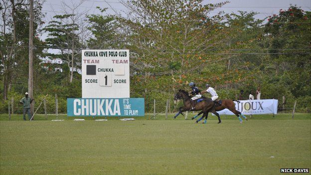 Two polo players involved in a match at the Kingston Polo Club - June 2014