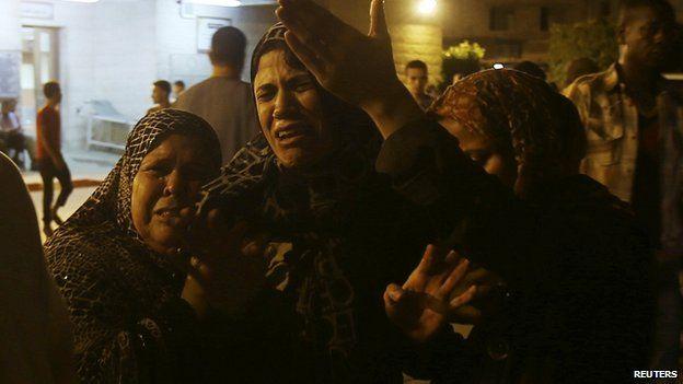Women mourn deaths of two Palestinians in Gaza. 6 July 2014