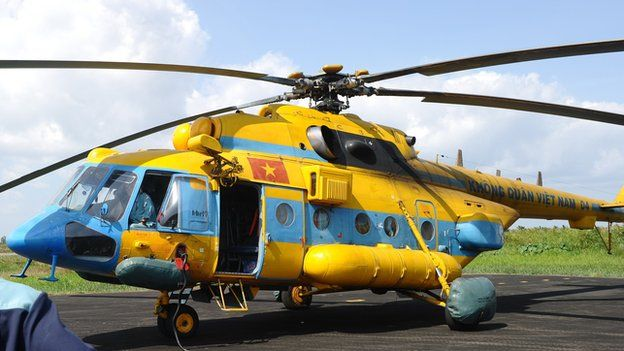 A Russian-made MI-171 helicopter is being prepared to go on a new search for the missing Malaysia Airlines flight MH370 in Ca Mau on 10 March, 2014