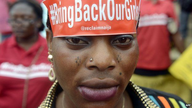 """A woman with a sticker on her head bearing the slogan """"Bring back our girls"""" marches for the release of the more than 200 abducted Chibok schoolgirls - Lagos, Nigeria (29 May 2014)"""