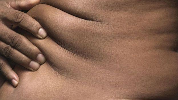 Fat on male body