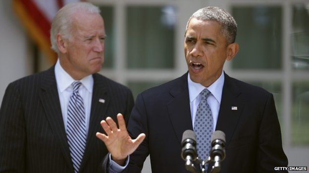 President Barack Obama (R) delivers remarks about the faltering immigration reform agenda to the news media with Vice President Joe Biden in the Rose Garden at the White House Washington, DC 30 June 2014