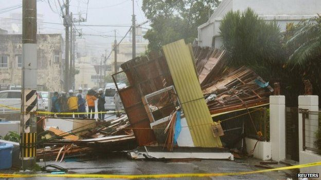 A wooden house which collapsed due to strong winds caused by Typhoon Neoguri is seen in Naha, on Japan's southern island of Okinawa, 8 July 2014