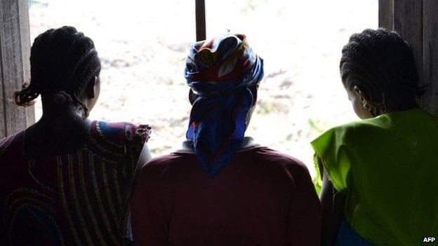 Three women at a camp for displaced people in eastern Democratic Republic of Congo. One of them was raped (22 August 2013)