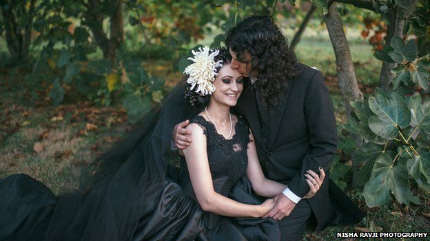 Bride and groom in black gothic-style wedding clothes
