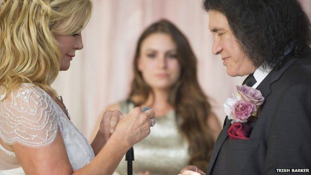 Gene Simmons and wife exchanging rings