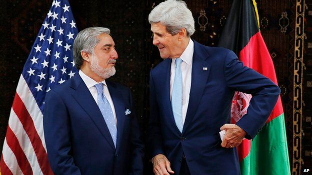 US Secretary of State John Kerry talks with Afghan presidential candidate Abdullah Abdullah at the start of a meeting at the US Embassy in Kabul, 11 July 2014.
