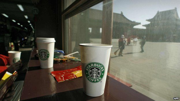 Coffee cups sit on the windowsill at the Starbucks coffee shop in Beijing's Forbidden City on 18 January 2007.