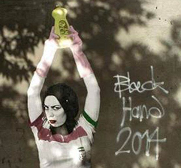 A piece of graffiti in Iran that's been widely shared, which shows a woman in an Iranian national shirt who is holding up a bottle of washing up liquid