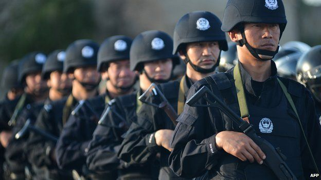 An anti-terrorism force including public security police and the armed police attend an anti-terrorism joint exercise in Hami, northwest China's Xinjiang region on 2 July, 2014