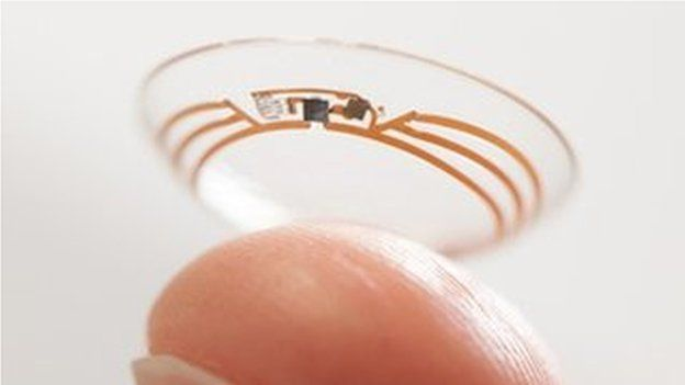 finger holding up Google contact lens prototype