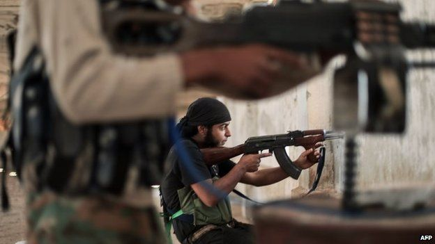 Rebel fighters from the Islamic Front clash with members of the Islamic State in Iraq and the Levant (Isis) in Aleppo province (13 July 2014)