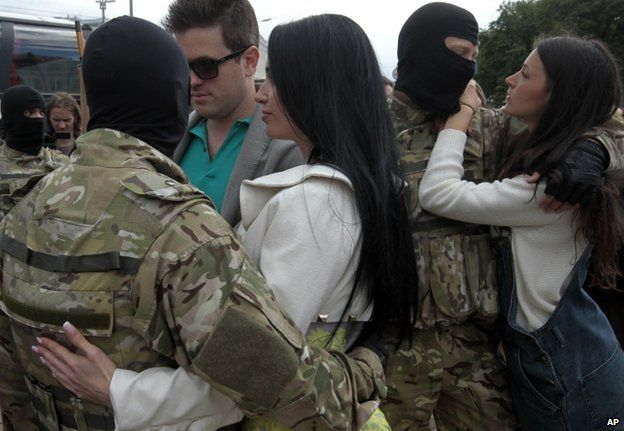 Young women say goodbye to Azov Battalion fighters in Kiev, 23 June