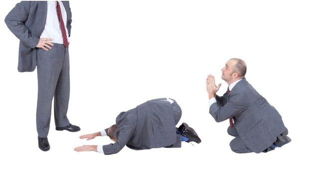 man in a suit bowing down