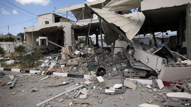 A building in Beit Hanoun, in northern Gaza, takes a hit from an Israeli air strike, 17 July