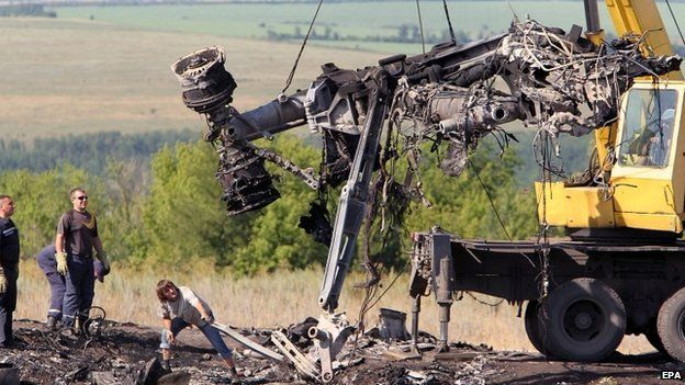 Ukrainian workers move debris from the site of the plane crash in eastern Ukraine - 20 July 2014
