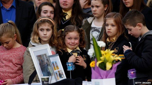 Mourners attend a memorial service in Melbourne held for a family of five killed in the flight MH17 crash - 20 July 2014