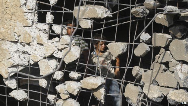 Palestinian children inspect a destroyed mosque in Rafah, southern Gaza. Photo: 22 July 2014