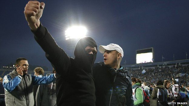 Zenit St Petersburg fans celebrate after a match between Zenit and Dynamo Moscow in April 2012
