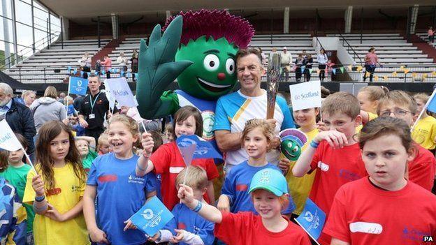 Duncan Bannatyne with Games Mascot Clyde at Ravenscraig Stadium, Greenock in Inverclyde