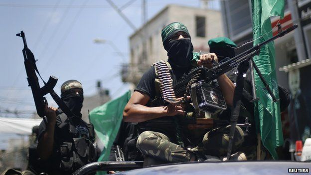 """Palestinian members of Hamas"""" armed wing take part in the funeral of their comrades in Gaza City June 21, 2014"""