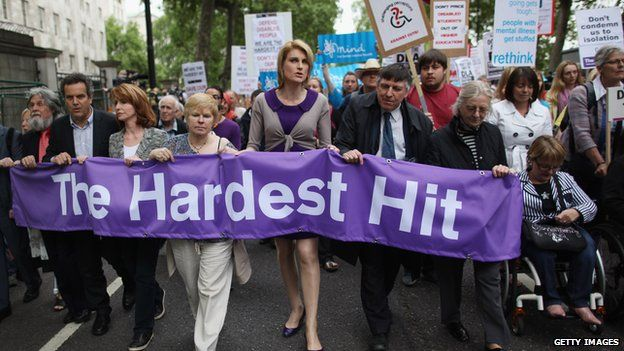 """Campaigners carrying a banner saying """"The Hardest Hit"""""""