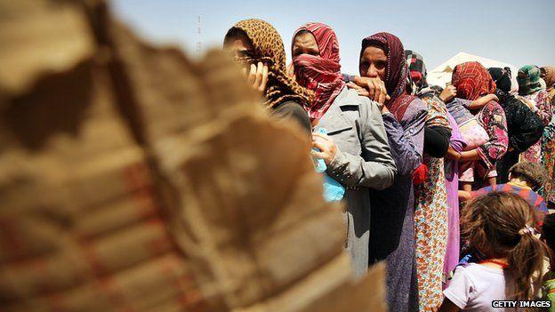 Desperate Iraqi women at the Khazair displacement camp on 30 June 2014 in Khazair, Iraq.