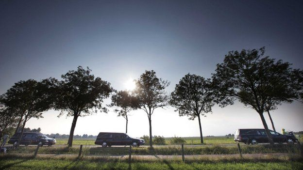 The column of funeral hearses drive near Nieuwegein after leaving the airbase in Eindhoven to Hilversum, The Netherlands, 26 July 2014,