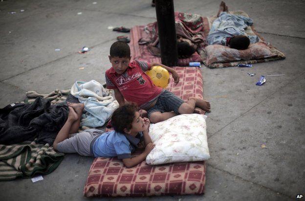 Palestinian children rest on the floor at a UN school in Jabaliya refugee camp, Gaza, 28 July