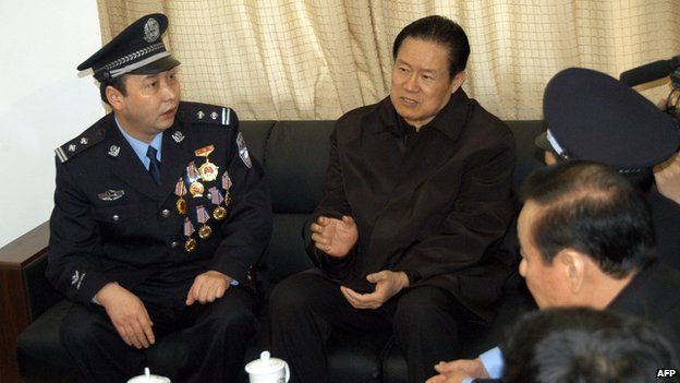 Mr Zhou with police officers, 2006