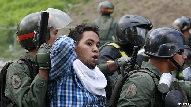 Venezuelan national guards detain an anti-government protester during a protest against President Nicolas Maduro's government in Caracas on 4 June, 2014