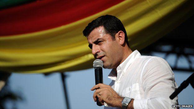 Turkish presidential candidate Selahattin Demirtas speaks to members of France's Kurdish community in Paris on 18 July.