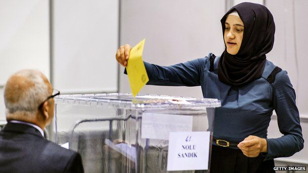 Woman casts her vote in the Turkish presidential election at a polling station in the Netherlands on 31 July 2014